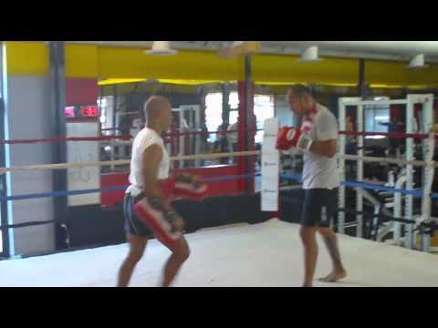 Brandon Vera and Buck Grant doing Thai pad work at the Hybrid Training Center Image 1
