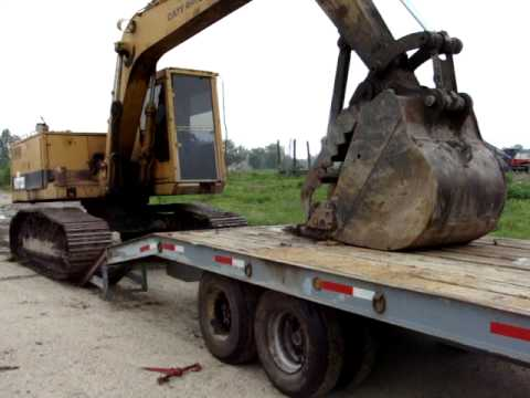 0 excavator loading on tag trailer
