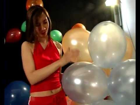 Woman Popping Balloons! video