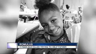 7-year-old killed trying to help father