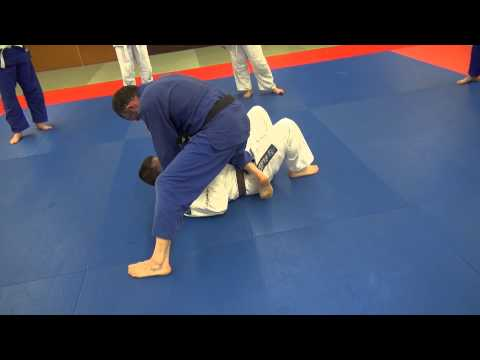 BJJ - Knee on belly escape - Hook under the foot Image 1