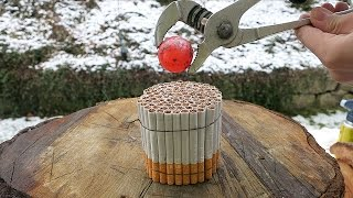 Glowing 1000 Degree Metal Ball vs 100 Cigarettes!