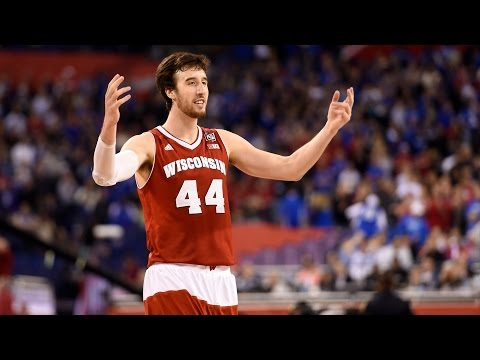 Wisconsin upset previously undefeated Kentucky in Final Four action 71-64, advancing to face Duke for the National Championship. Frank Kaminsky led the Badgers with a 20 point, 11 rebound ...