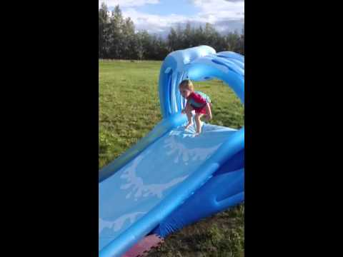 Scarlett jumping on the slip and slide