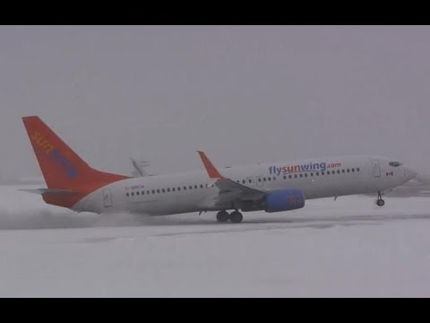 A newly delivered Sunwing Airlines Boeing 737-81D ( C-GNCH ) takes off in a snowstorm from Gander International Airport ( CYQX ) for Juan Gualberto Gomez International ( MUVR ).