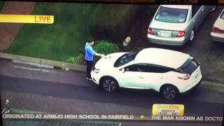 Man walking around with rifle draws a dick on car on The news