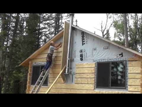 THE BACKWOODS CABIN Episode 16. Ceiling Beams and Siding. Two days Of Work In Just Over 8 Minutes.