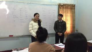 Instructor Noy students sing Hmong song in Laos