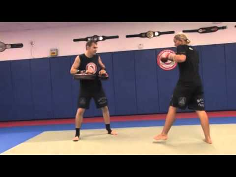 How To Do a Three Punch Set Up for Round Kicks - Kickboxing Lesson Image 1