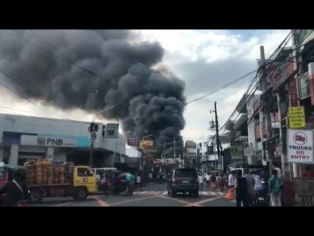 Fire hits residential area, market in Pasig