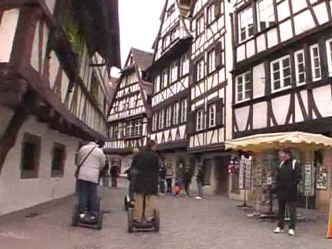 Strasbourg Segway city trip. Six androids walk on a city