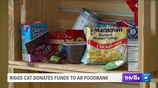 Riggs Cat Donates Funds to Arkansas Foodbank