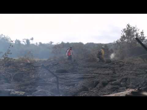 USGS workers survey the damage left by the Puna Lava Flow