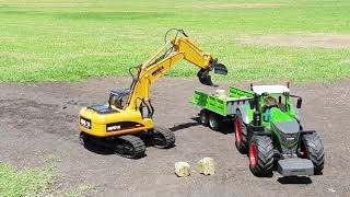 RC Fendt 1050 Vario tractor, RC tipping trailer, and RC Huina excavator claw set