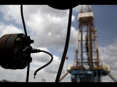 Oil prices edge higher in thin trade; OPEC eyed