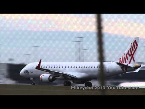 Virgin Australia x 2 take off Melbourne Airport 22May13 mid-day ish