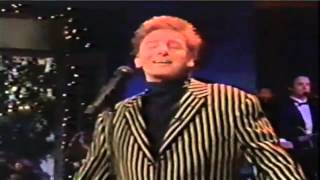 Watch Barry Manilow And The Angels Sing video