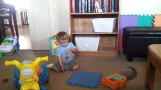 Lucas putting things in and taking things out of a container...repeatedly!