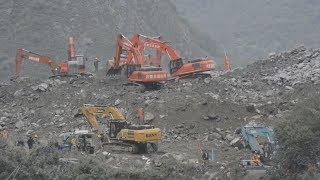 中国山崩れ、救出作業続く