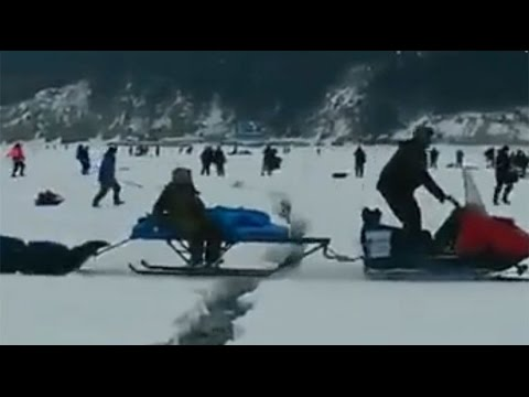 Disaster film-style escape: Fishermen dash for safety as frozen lake cracks underfoot in Russia