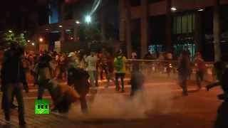 Tears & Teargas  Protesters clash with police in (Venezuela)   4/5/14