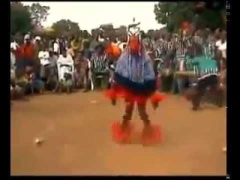 A dancing man on a stick - amazing african tribal dance - Zaouli Dance