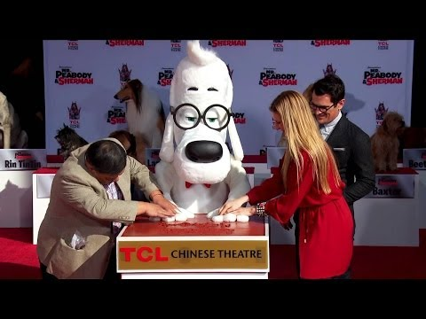 Mr. Peabody cements his paw prints at the Chinese Theater in Hollywood with Sherman