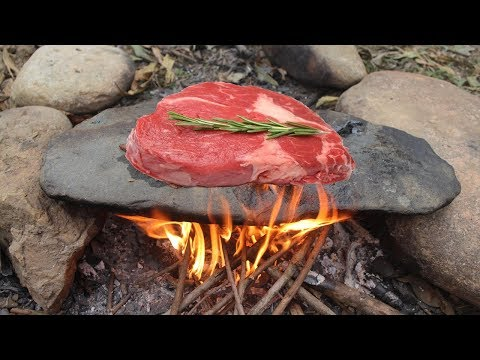 Primitive Survival Cooking Meat on a Rock