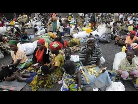 Displaced Congolese flee violence, head to UN base
