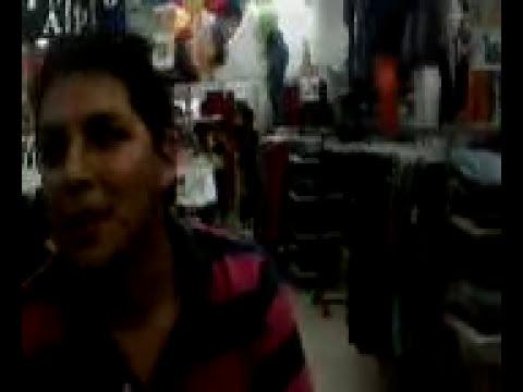 florcita y nestor discutiendo en una tienda de gamarra.avi