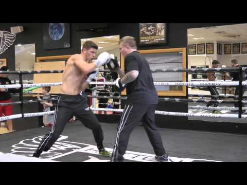 Reuben Arrowsmith pads with Ricky Hatton