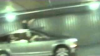 Guy smacks head really hard in underground parking lot
