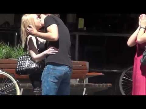 Guy kisses random girls in public