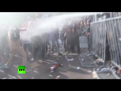 Hungarian police use tear gas, water cannon on refugees at border