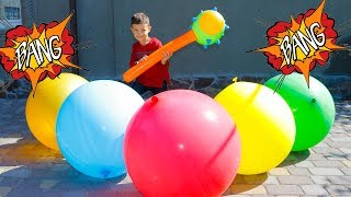 Funny Danya Ride on Power Wheel Car BMW X6 and play with colored Balloons for kids children