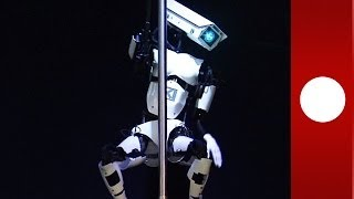 Pole-dancing robot performs for Merkel and Cameron at CeBIT techfest in Hanover