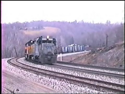 With train 396, CSX GP30 4224 leading Chessie 6012 & 6105, clawing its way up the steepest part of Sand Patch grades west side in number 8 notch. We are at Keystone, Pa. On the rear is Chessie...