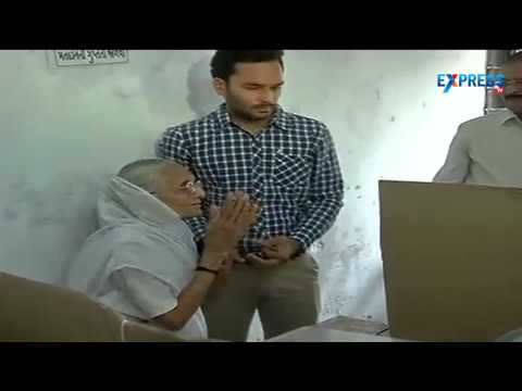 Narendra Modi's mother casting her vote in Vadodara in Gujrat - Election 2014
