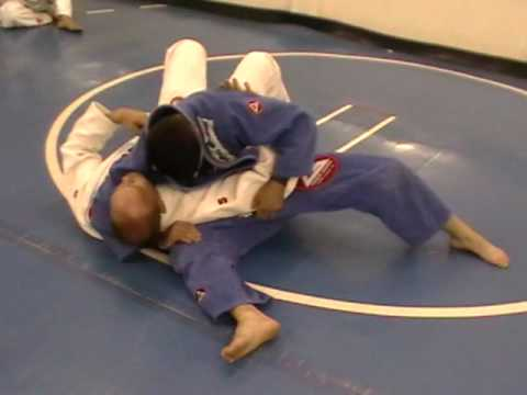 BJJ Techniques: Bridge and Roll Escape from under Classic Kesa Gatame Image 1