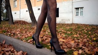 High heels Outdoors Walking. Grey pantyhose & black  miniskirt