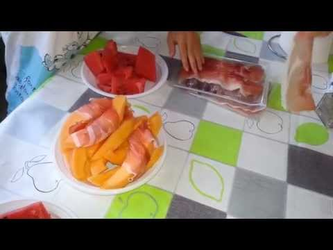 Italian delicacy: melon wrapped in prosciuto