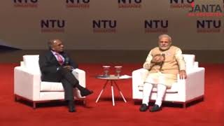 Does Modi's translator in Singapore reveal that PM's interview and his answers are scripted?