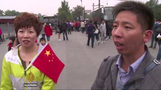 Muted celebration as China marks 65th National Day