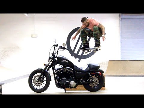 Skateboarding Over A Harley