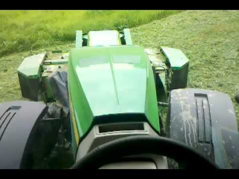 John Deere 8360R with triple mowers and AutoTrac!