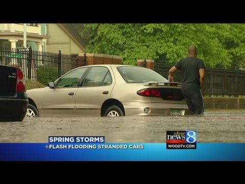 Hail, heavy rain, brief flooding