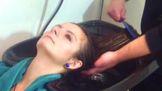Shampooing a young woman with long curled hair