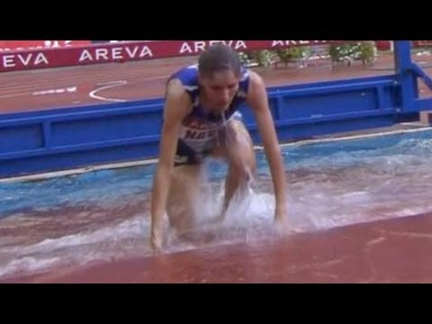Steeplechase runner belly flops into water - from Universal Sports