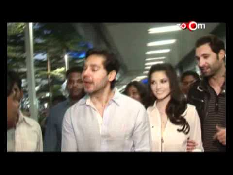 Dino Morea receives Sunny Leone at the airport