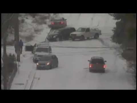 0 2010 USA Cars sliding and crashing down icy hill in the snow!